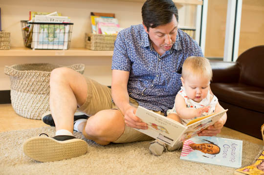 Dad and a child reading a book